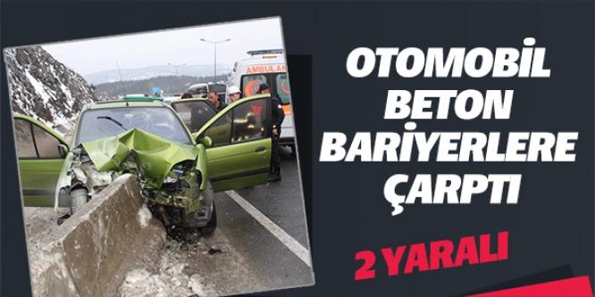 OTOMOBİL BETON BARİYERLERE ÇARPTI; 2 YARALI