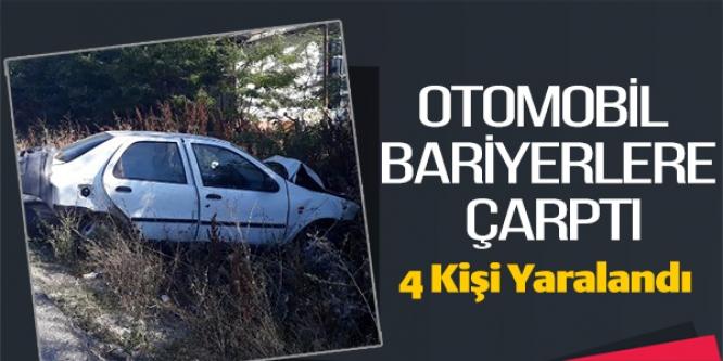 OTOMOBİL BARİYERLERE ÇARPTI; 4 YARALI